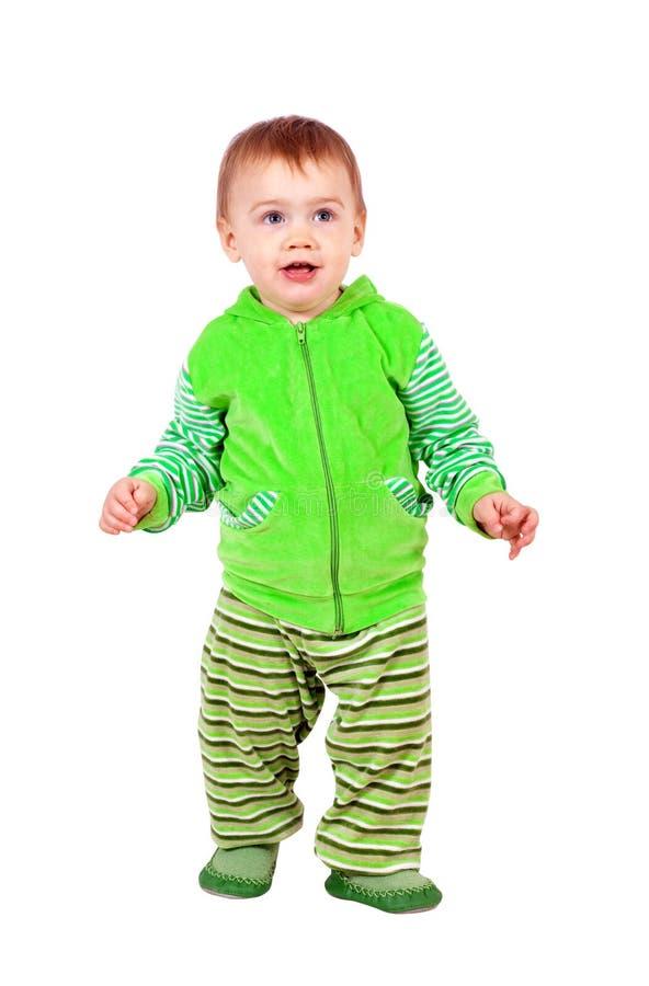 Toddler walking over white. Happy toddler walking over white background royalty free stock photos