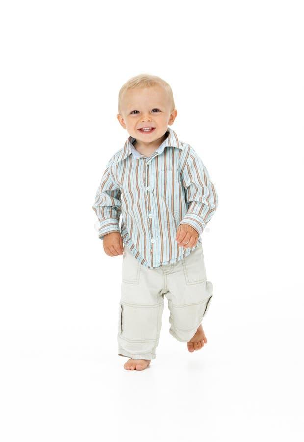 Toddler Walking In Studio. On White Background stock image