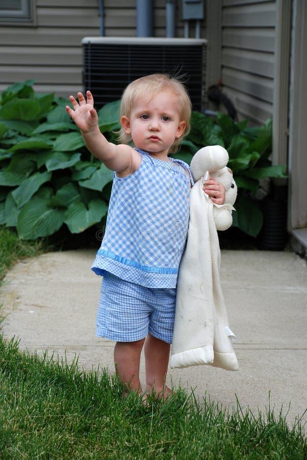 Toddler waving goodbye stock image