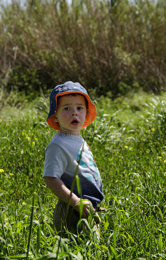 Toddler wearing a hat at nature reserve royalty free stock photo
