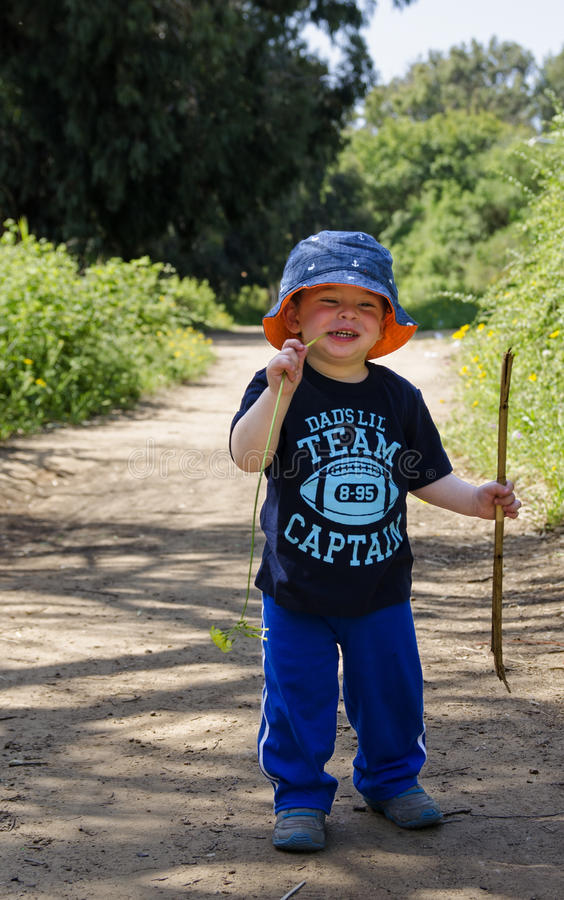 Toddler wearing a hat at nature reserve stock image