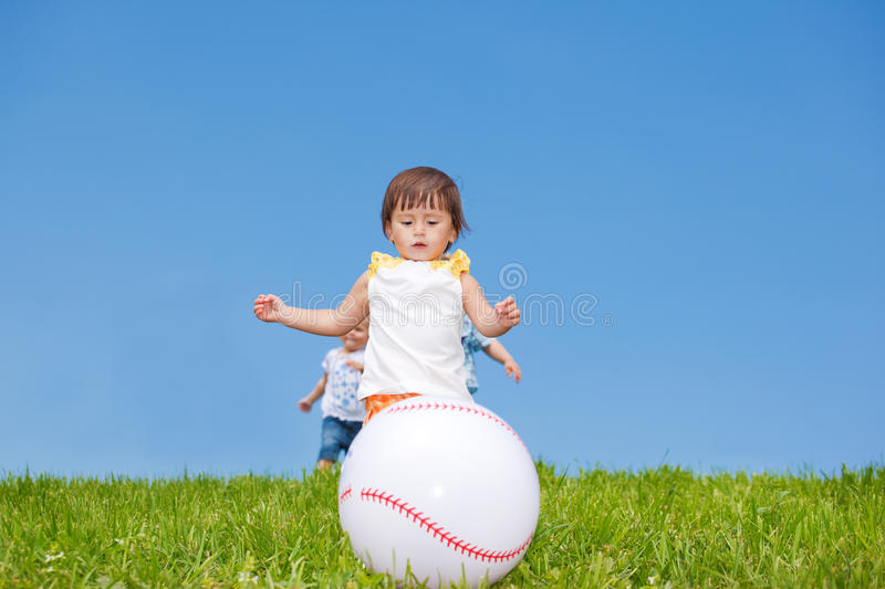 Toddlers catching the ball royalty free stock image