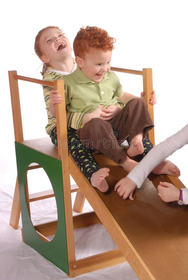Toddlers on Playground Slide stock photography