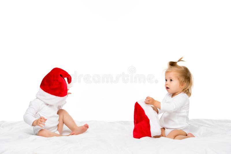 cute toddlers in santa hats royalty free stock image
