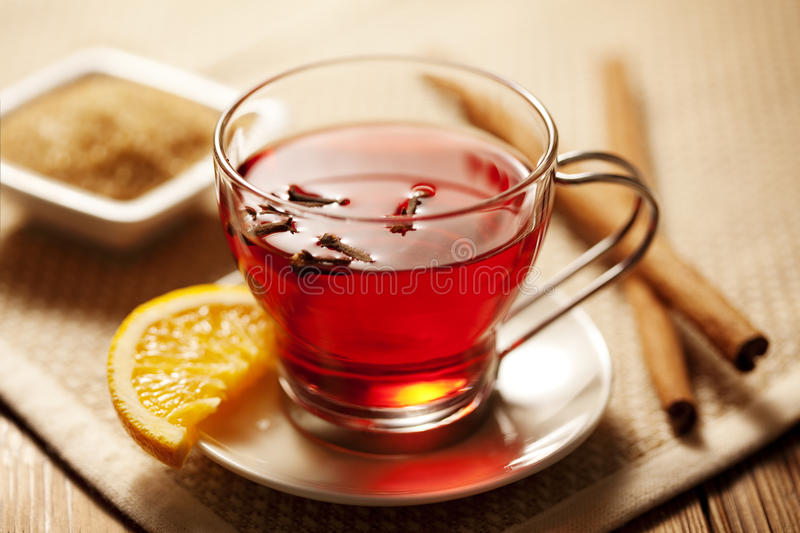 Toddy or mulled wine. Inviting warm spicy drink with ingredients stock photo