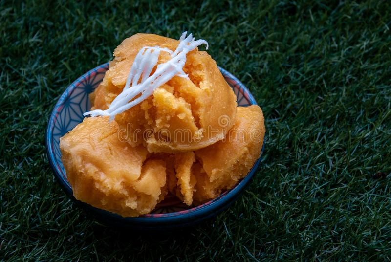 Toddy Palm Cake or Kanom Tarn is local Thai Dessert, sweet, soft and delicious. Made from ripen toddy palm, scraped coconut, and stock image
