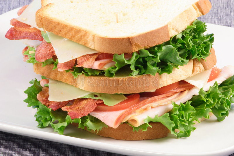 Todo o sanduíche de clube americano foto de stock