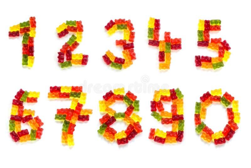 Todos los dígitos a partir de la 0 a 9 hicieron de ingenio aislado los osos gomosos coloridos foto de archivo libre de regalías