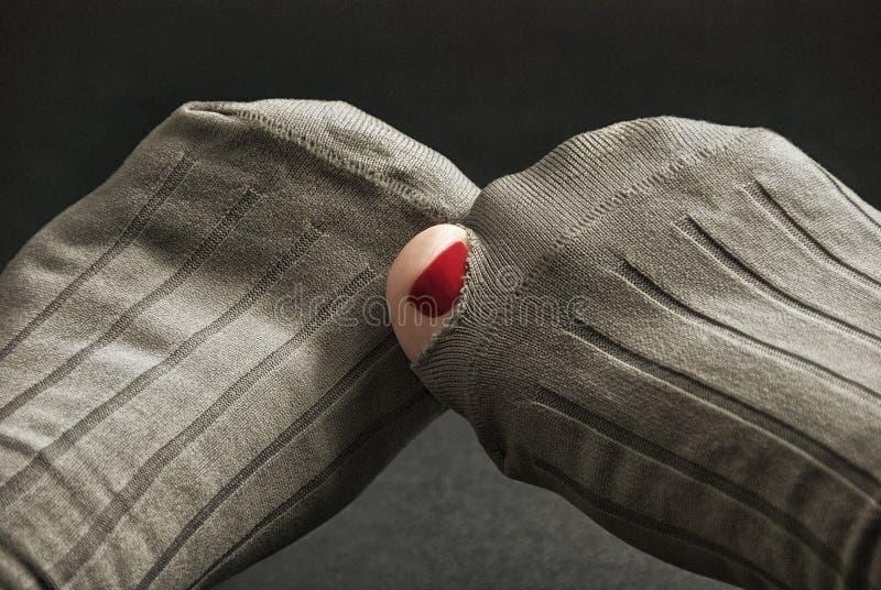 Toe Sticking Out del agujero en calcetín foto de archivo libre de regalías