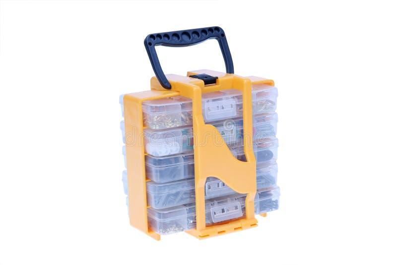 Toebehoren in doos stock afbeelding