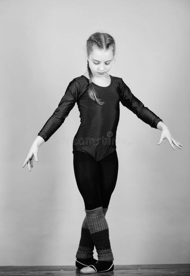 Toekomstige ster van ritmische gymnastiek De ritmische gymnastieksport combineert de dans van het elementenballet Probeer hard Me stock afbeeldingen
