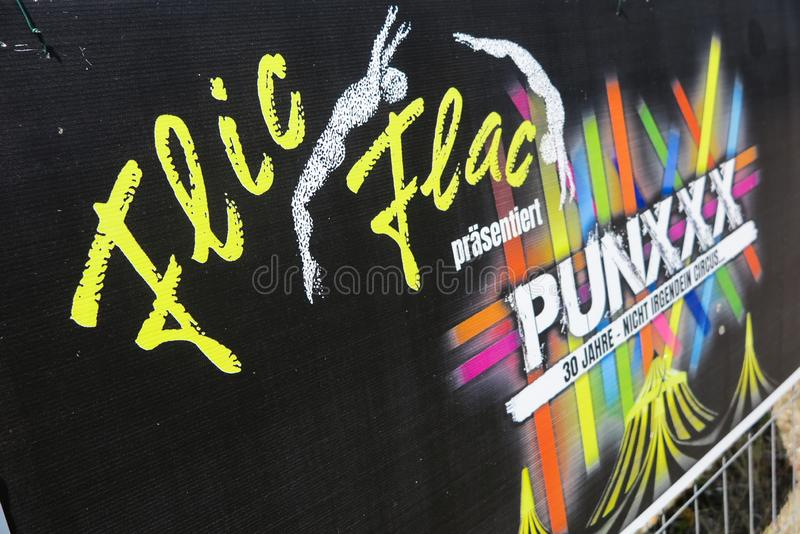 TOENISVORST, GERMANY - JUIN 28. 2019: Close up of cardboard advertising of Flic Flac anniversary tour Punxxx royalty free stock images