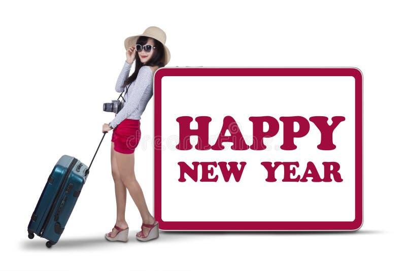 Toerist met nieuwe jaarteksten royalty-vrije stock afbeelding