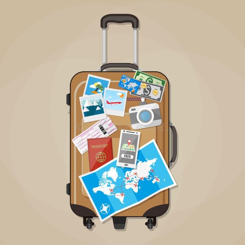 Toeristenmateriaal op bruine reiskoffer stock illustratie