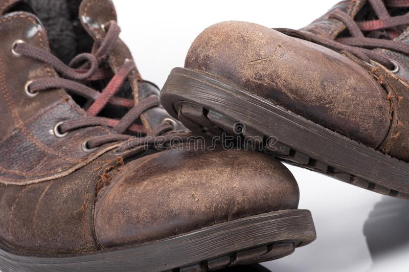 An old brown leather boots royalty free stock image