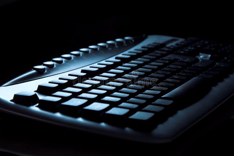 Toetsenbord in dark stock fotografie