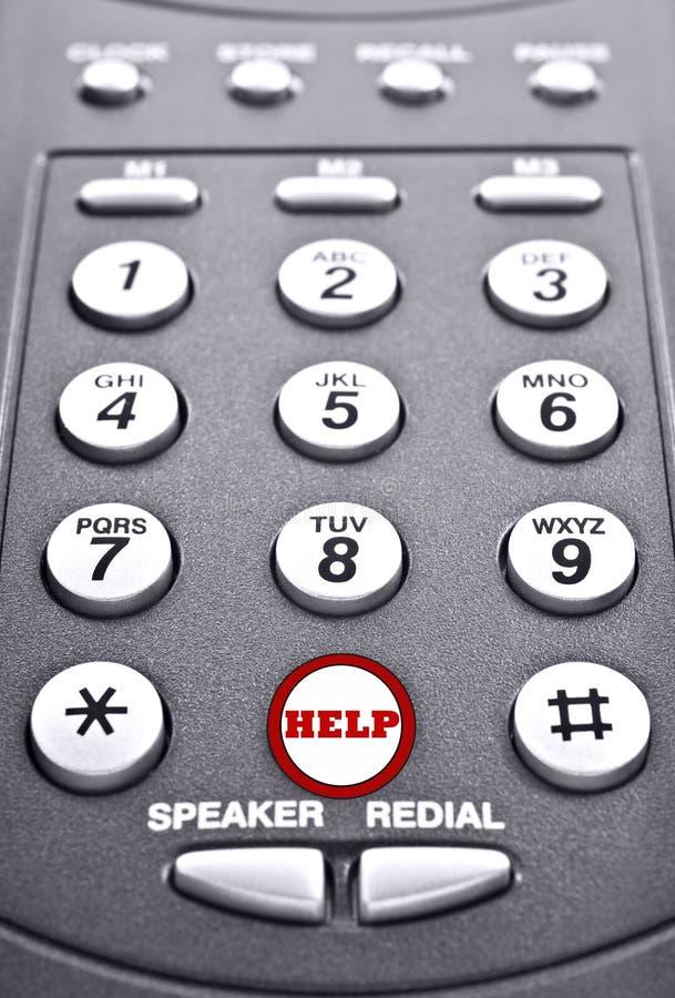 Toetsenbord van een telefoon met een rode knoop voor hulp royalty-vrije stock foto's