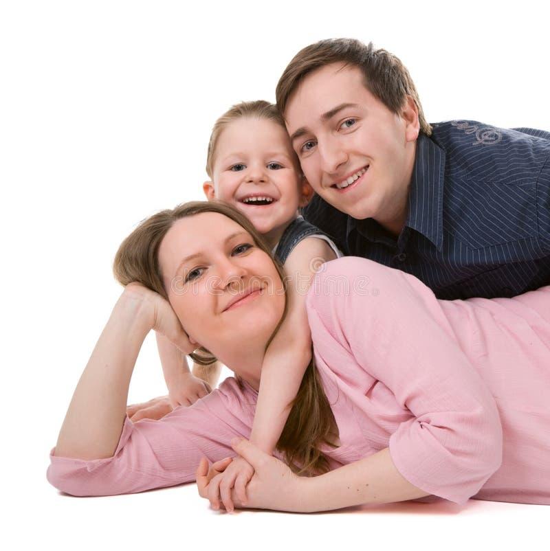 Toevallig portret van gelukkige jonge familie royalty-vrije stock foto
