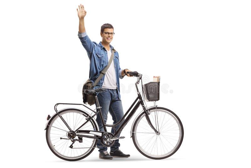 Toevallige jonge mens met fiets het golven royalty-vrije stock foto