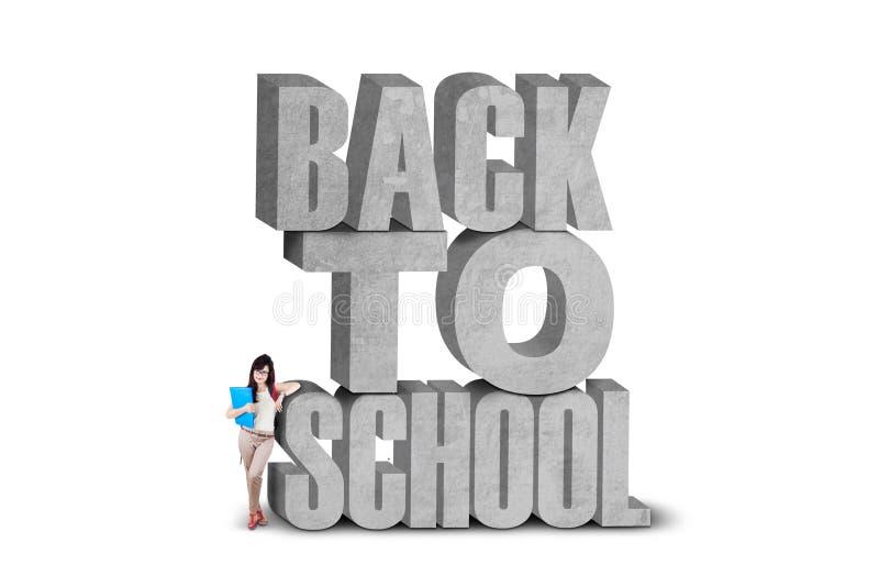 Toevallige leerling met tekst van terug naar school stock foto's