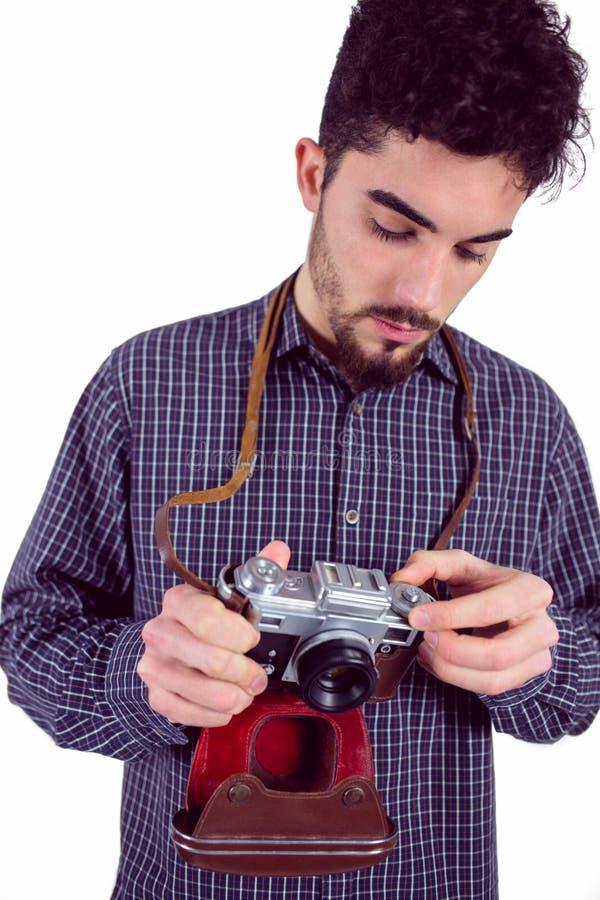 Toevallige mens die zijn camera houden royalty-vrije stock foto's