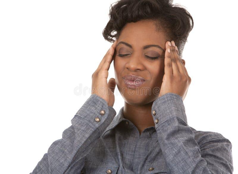 Vrouw en hoofdpijn stock afbeelding