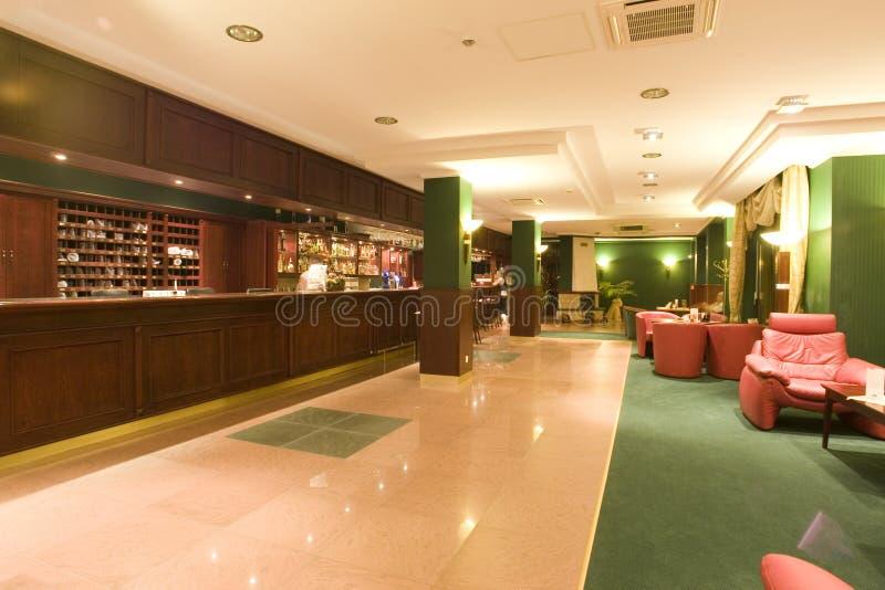 Toevlucht of de hal en de zitkamer van het Hotel stock afbeeldingen