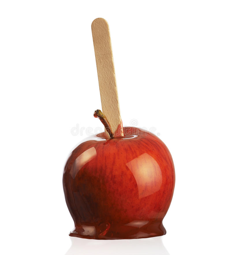 Toffee apples. Sweet red toffee apple on white background stock images