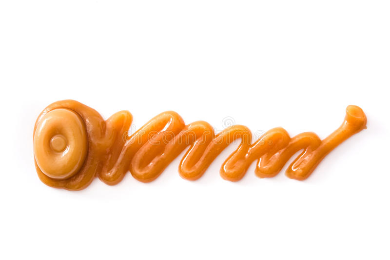 Toffee caramel candy and caramel sauce isolated. On white background. Copyspace stock image