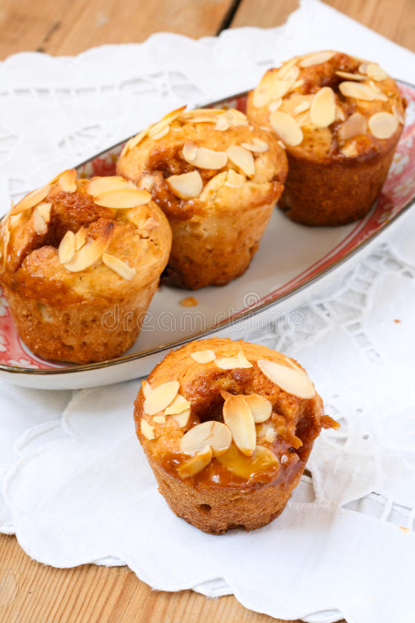Toffee and pear muffins stock photos