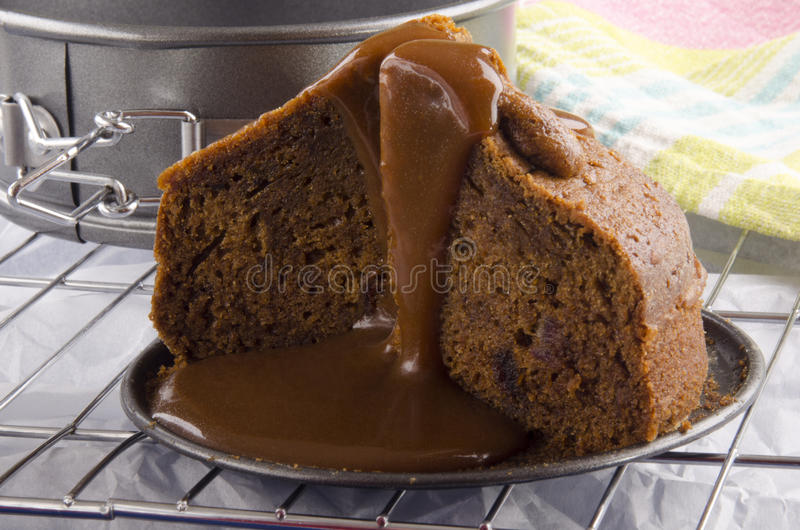 Toffee pudding with caramel sauce stock photography