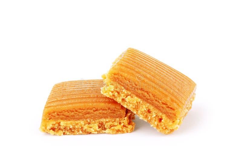 Toffeekaramel-Süßigkeitsnahaufnahme lokalisiert auf weißem Hintergrund stockfotografie