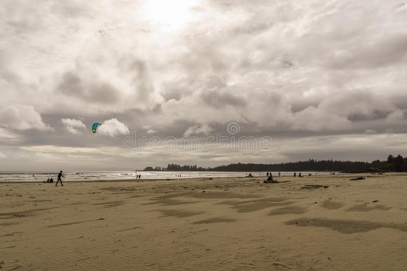 TOFINO, CANADA - September 2, 2018: Kiteboarding or wave riding in the pacific ocean.  royalty free stock photos