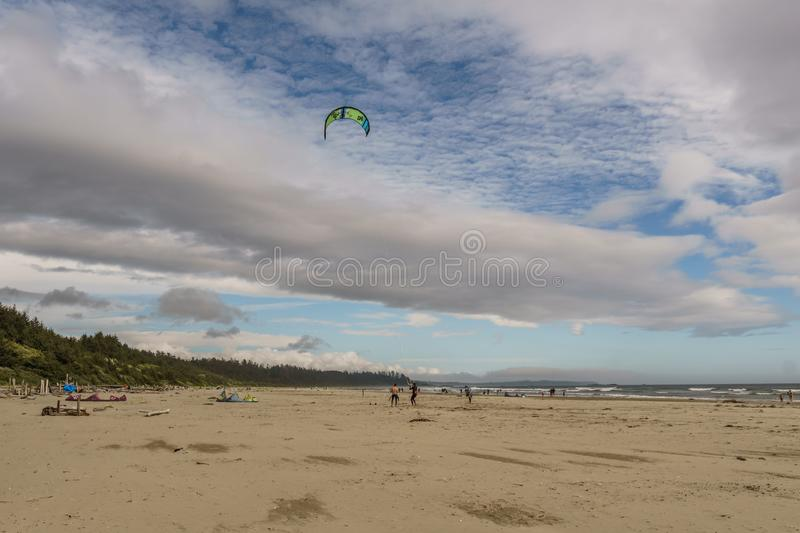 TOFINO, CANADA - September 2, 2018: Kiteboarding or wave riding in the pacific ocean.  stock photography