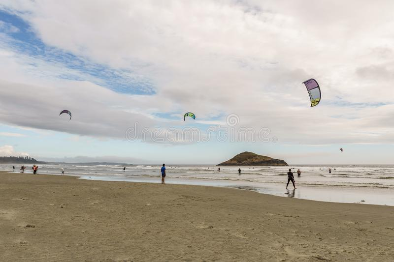 TOFINO, CANADA - September 2, 2018: Kiteboarding or wave riding in the pacific ocean.  royalty free stock image