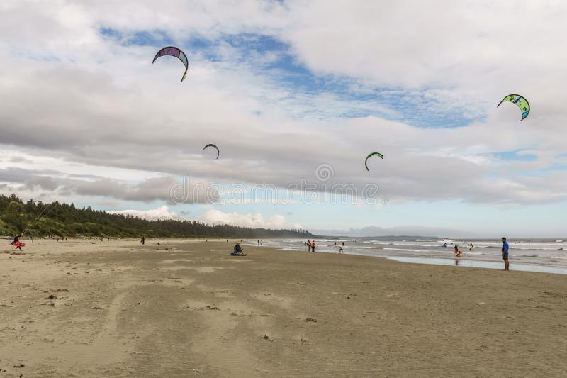 TOFINO, CANADA - September 2, 2018: Kiteboarding or wave riding in the pacific ocean.  royalty free stock photography