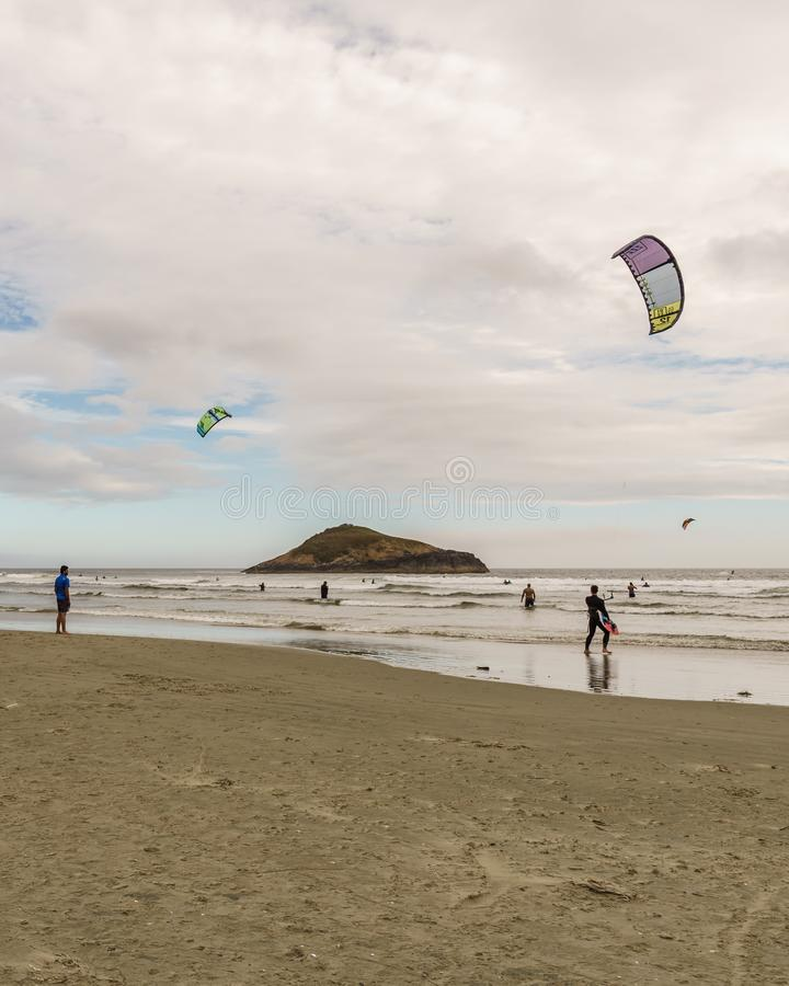 TOFINO, CANADA - September 2, 2018: Kiteboarding or wave riding in the pacific ocean.  stock image
