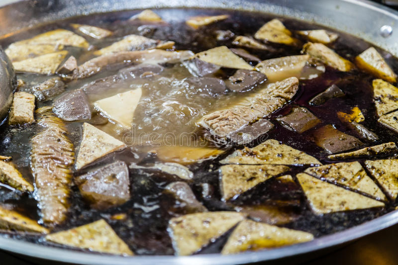 Tofu boiling in steel pot. On a vendor`s table at night market royalty free stock images