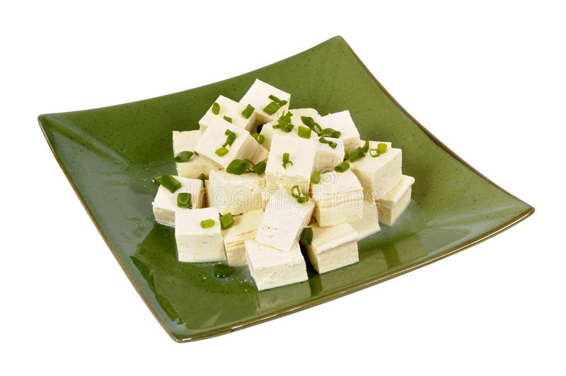 Asian vegetarian food : Tofu cubes with spring onion garnish royalty free stock photos