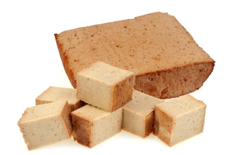 Tofu cut into pieces on white background stock image