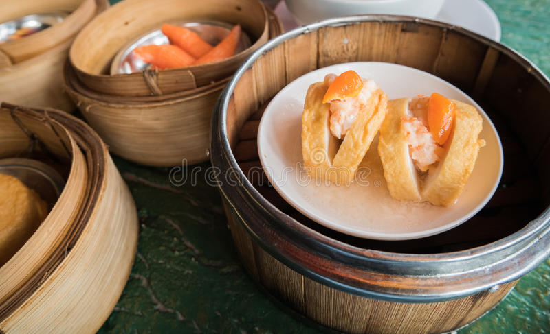 Tofu fish in Dim Sum basket. Tofu fish in Dim Sum basket royalty free stock photography