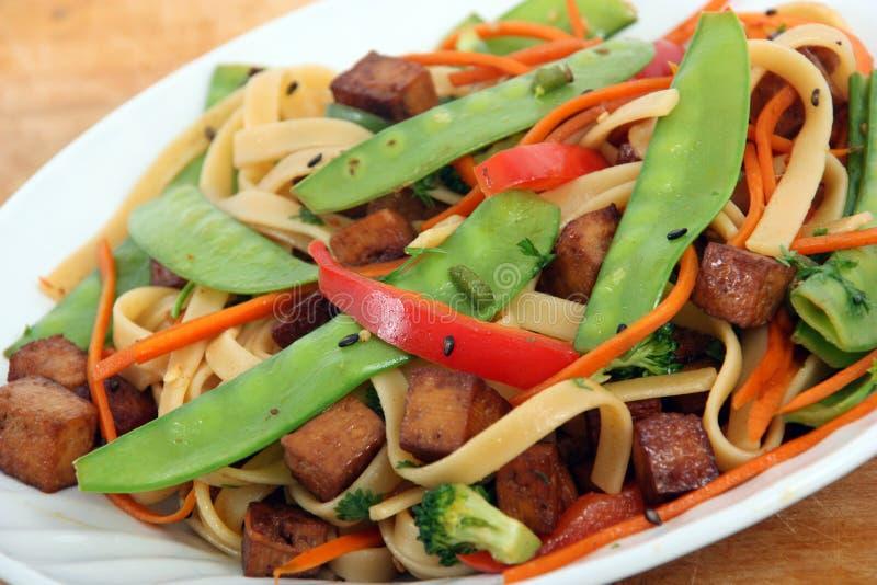 Tofu noodle stir fry. With noodle stock photo