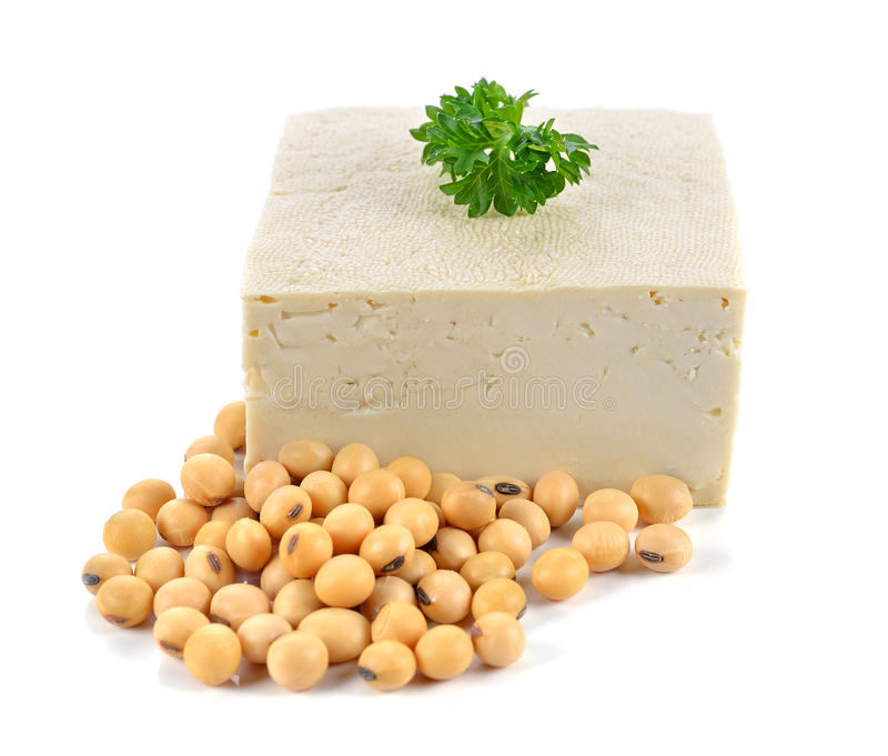 Tofu and soybeans. On white background royalty free stock photos