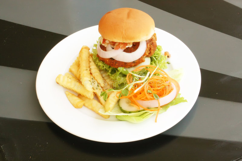 Tofu Vegetarian Burger With French Fries royalty free stock photos