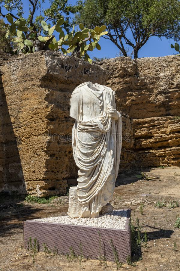 Togati marble statue, torso in Valley of Temples, Agrigento, Sicily. One of most examples of Roman art and architecture in Italy. royalty free stock photography