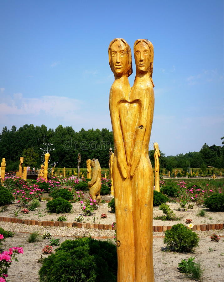 Togeather in Love. Wooden sculpture with two people (men and women) symbolizing love and unity stock image