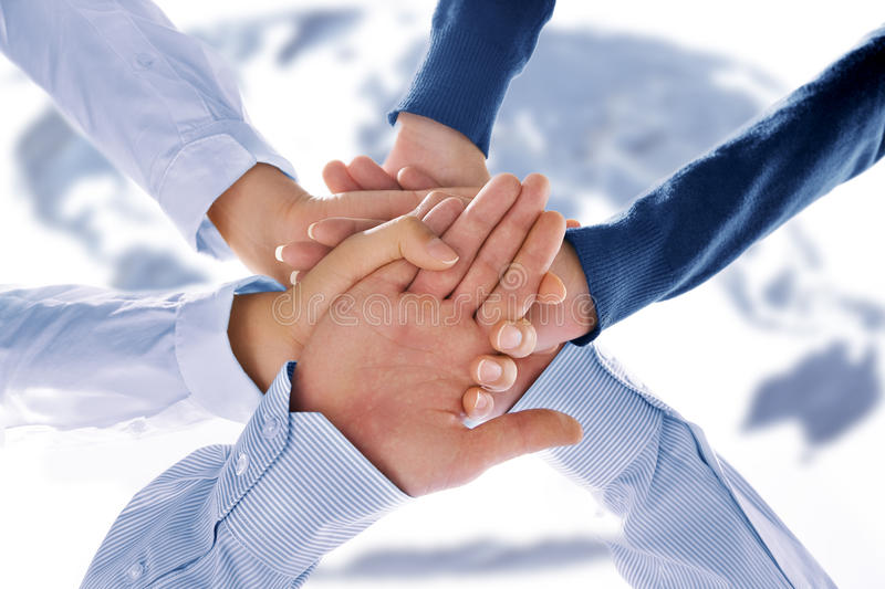 Together. Close up view of hands getting together in office environment stock photography