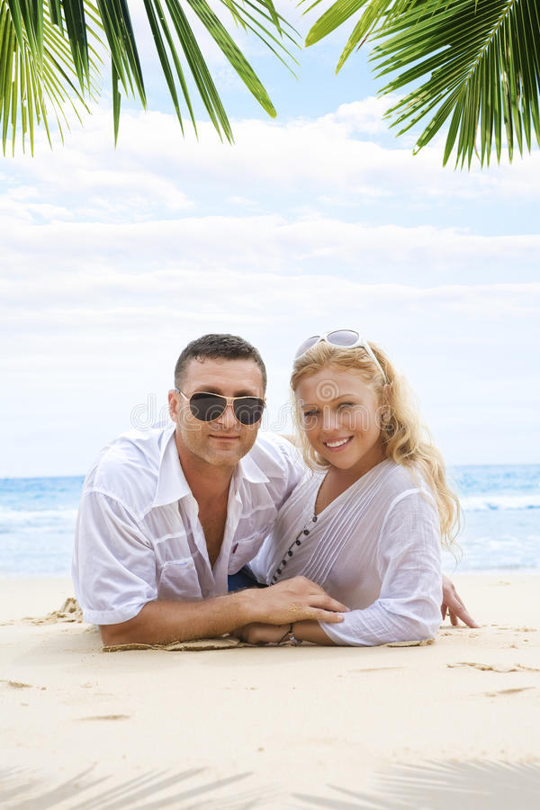 Together. Portrait of young nice couple having good time on the beach stock images