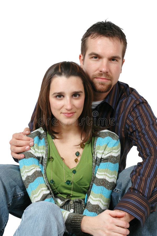 Together. Happy couple. Togetherness. Sitting down royalty free stock image