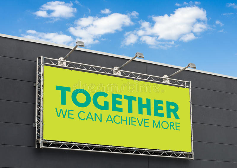 Together we can achieve more. Written on a billboard royalty free stock images
